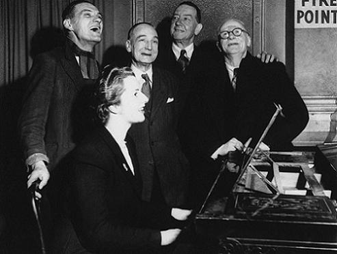 With voters on the piano in a sing along after a brief political argument in the bar of the Bull Inn, Dartford, England in 1950