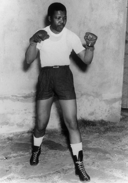 Nelson Mandela adopts a boxing pose, circa 1950 --Picture Keystone-Hulton Archive-Getty Images