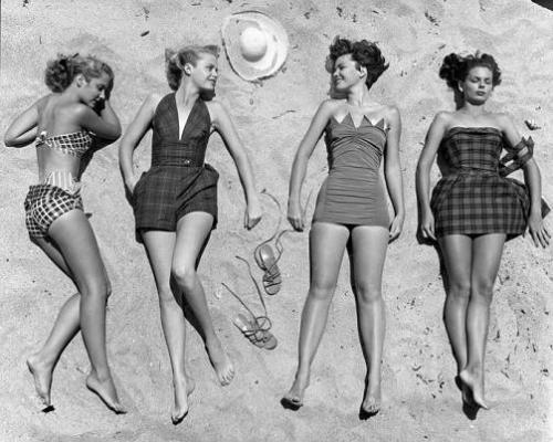 Models sunbathing, wearing latest beach fashions.