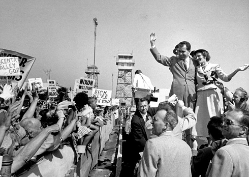 Nixon and his wife are surrounded by a crowd at the Los Angeles airport during the 1952 campaign.